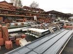 Ensemble des tuiles, faîtières, rives, goulottes, bois situées à l'extérieur + environ 15 m de rack...
