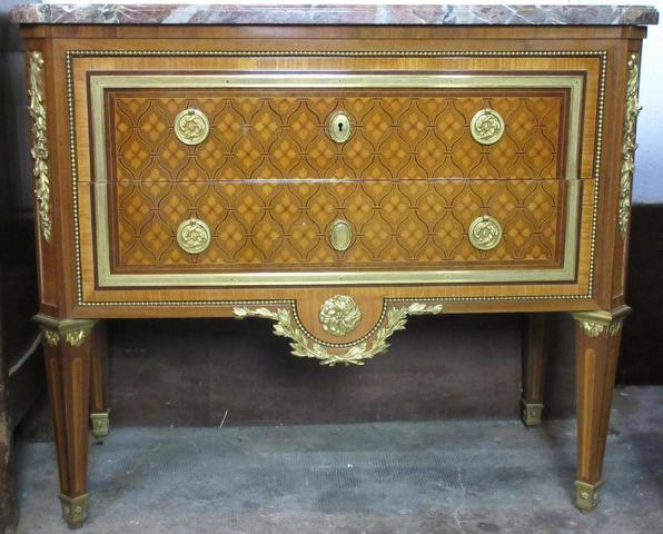 Paul SORMANI. Commode en bois de placage de style Louis XVI, décor
