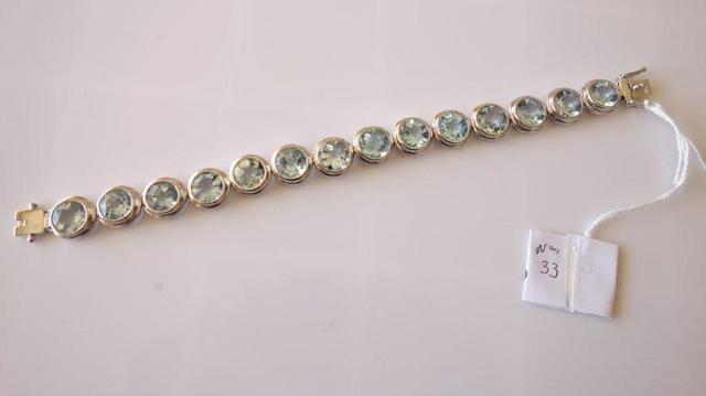 GU6896 - Bracelet en argent serti de 14 topazes  bleues en serti