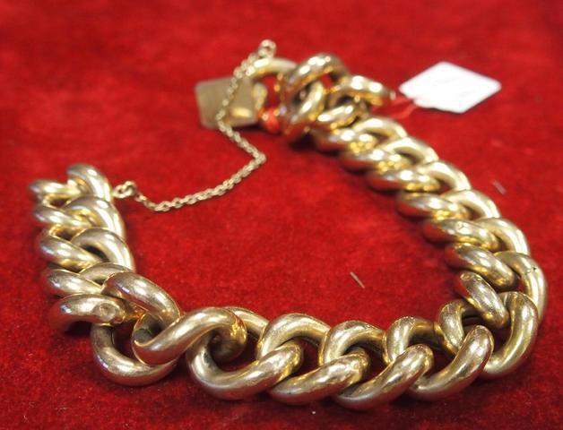 Bracelet en or jaune à grosses mailles gravée Marcelle. Poids net