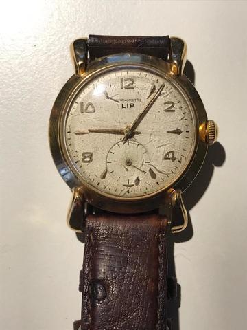 LIP Elgiloy chronomètre. Montre barcelet à boîtier en or jaune.