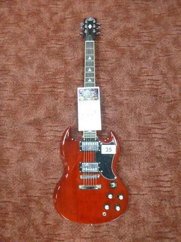 une guitare électrique JM FOREST GS 300 WINE RED de style GIBSON