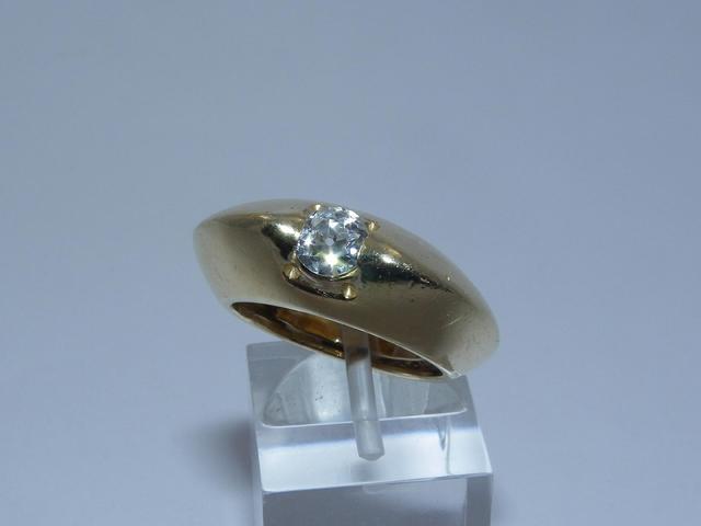 Bague jonc en or sertie d'un diamant d'environ 0.40/0.50 carat