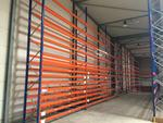 23 racks à palettes lourds bleu et orange de 4 m de longueur unitaire