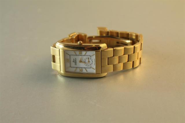 Montre d'homme en or Jean DELATOUR sur bracelet articulé à boucle