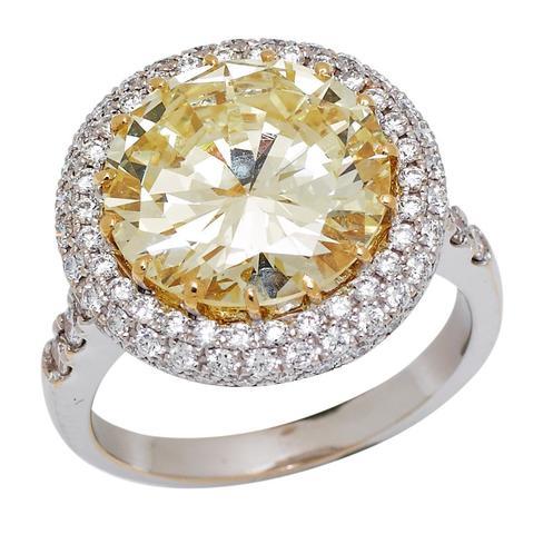 Important diamant rond taille brilliant pesant 6,39 carats monté