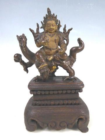 TIBET - XVIIIe siècle Statuette de Kubera en bronze partiellement