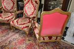 Suite de 4 fauteuils à dossier plat de style Louis XV en bois doré,