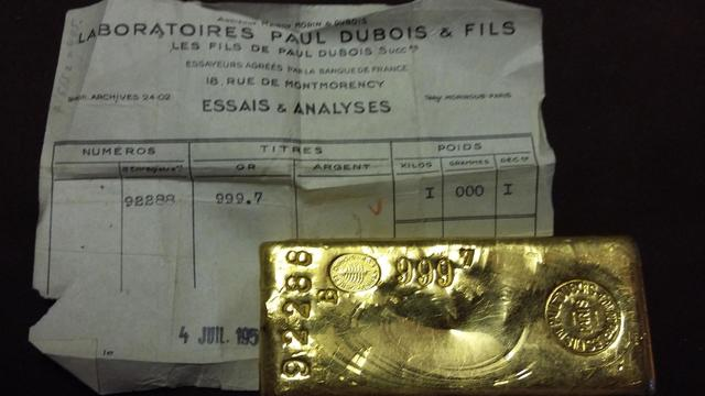 un lingot d'or de 1kg, titre 999.7, avec buleltin d'essai